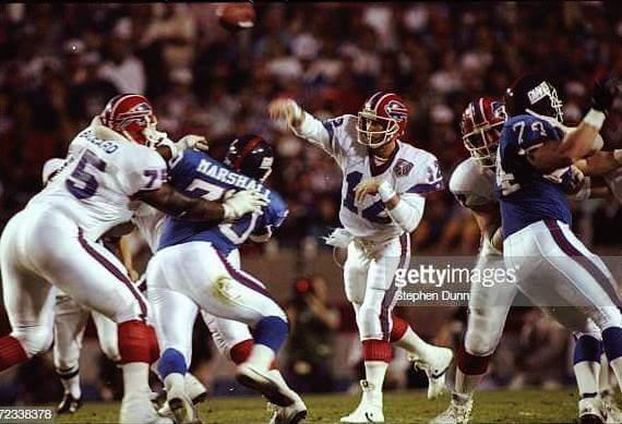 12 Jan 1991: Quarterback Jim Kelly #12 of the Buffalo Bills throws the ball against the New York Giants during Super Bowl XXV at Tampa Stadium in Tampa, Florida. The Giants won the game, 20-19.