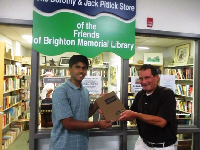 Offering volume to Salman Syed, Friends of the Library volunteer, 8/1/17