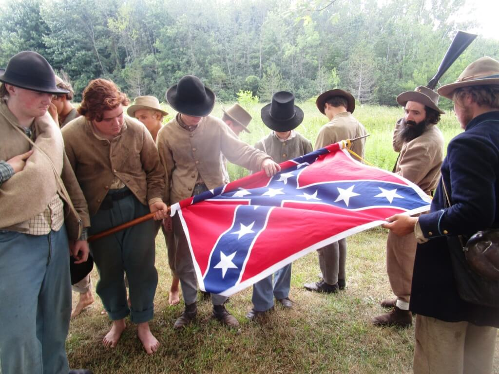 "Recreation of ""Rebel Veterans furl the Stars and Bars for the last time before starting for home"" from The Golden Book of the Civil War: ""Monroe Wildcats"" representing the 1st Tennessee Dismounted Cavalry. Tinker Homestead and Farm Museum 8/6/16"